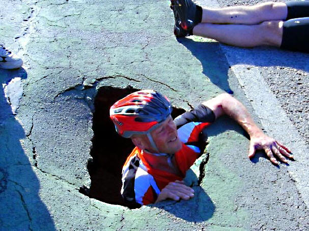 Cyclist in Pothole photo